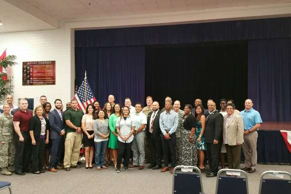 The first graduating class of the Onward to Opportunity Program at Joint Base San Antonio poses for a photo after a graduation ceremony Thursday morning. The O2O Program helps veterans and their families transition to civilian life by helping teach valuable job skills such as resume writing and how to interview, as well as provides networking opportunities with local businesses.