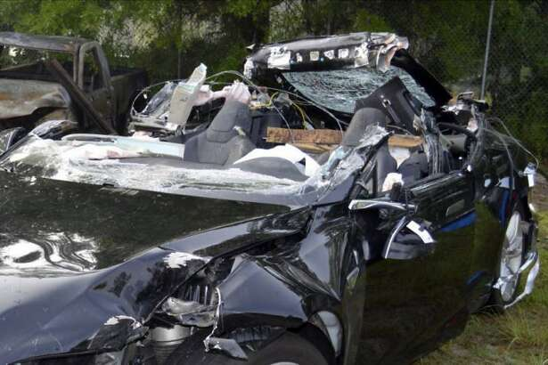 FILE - This file photo provided by the National Transportation Safety Board via the Florida Highway Patrol shows the Tesla Model S that was being driven by Joshua Brown, who was killed when the Tesla sedan crashed while in self-driving mode on May 7, 2016. A person familiar with the discussions says Tesla has told Senate committee staffers that its engineers have two main theories about what caused the fatal crash. Both involve the car's cameras and radar. Tesla officials disclosed the theories a briefing with U.S. Senate Commerce Committee staff members Thursday, July 28, 2016, said the person, who didn't want to be identified because the meeting was private. (NTSB via Florida Highway Patrol via AP, File)
