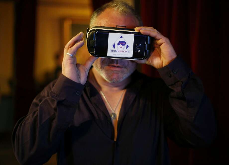 Aeko Litrell of Holofilm Productions uses a VR device during the gathering in San Francisco. Photo: Connor Radnovich, The Chronicle