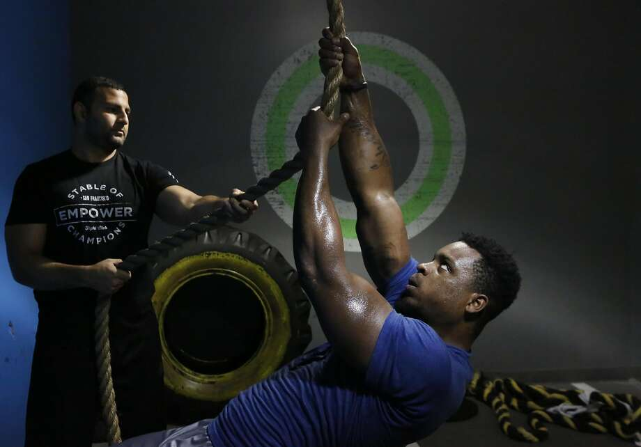 Instructor Tareq Azim encourages Dion Jordan during a training session with professional athletes at Empower July 21, 2016 in San Francisco, Calif. Photo: Leah Millis, The Chronicle