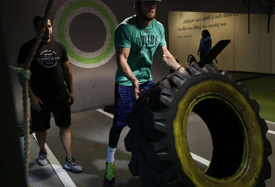 Instructor Tareq Azim encourages Cooper Helfet during a training session with professional athletes at Empower July 21, 2016 in San Francisco, Calif. Photo: Leah Millis, The Chronicle