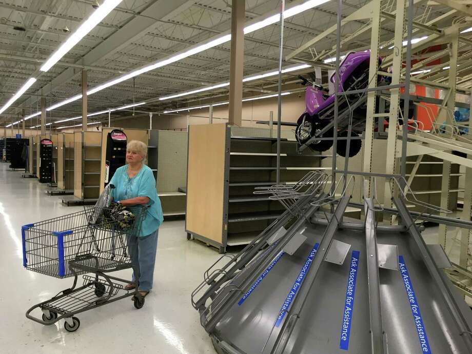 Marianne Lynk, of Derby, looks around the Derby Walmart Friday, July 29, 2016 after stopping in to the store on its last day in business. Photo: Autumn Driscoll, Hearst Connecticut Media / Connecticut Post freelance