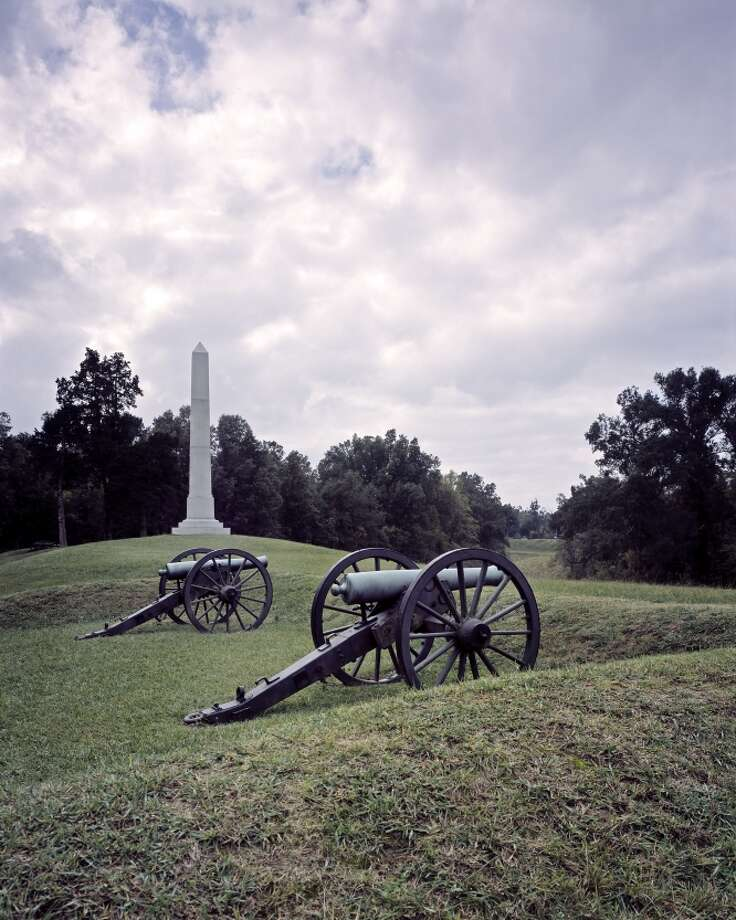 A view of Civil War earthworks, cannon and the Michigan monument in Vicksburg National Military Park, Mississippi. Vicksburg was key to control of the Mississippi River and the South during the Civil War. The Union's victory here in July 1863 after a 47-day siege was a critical turning point.