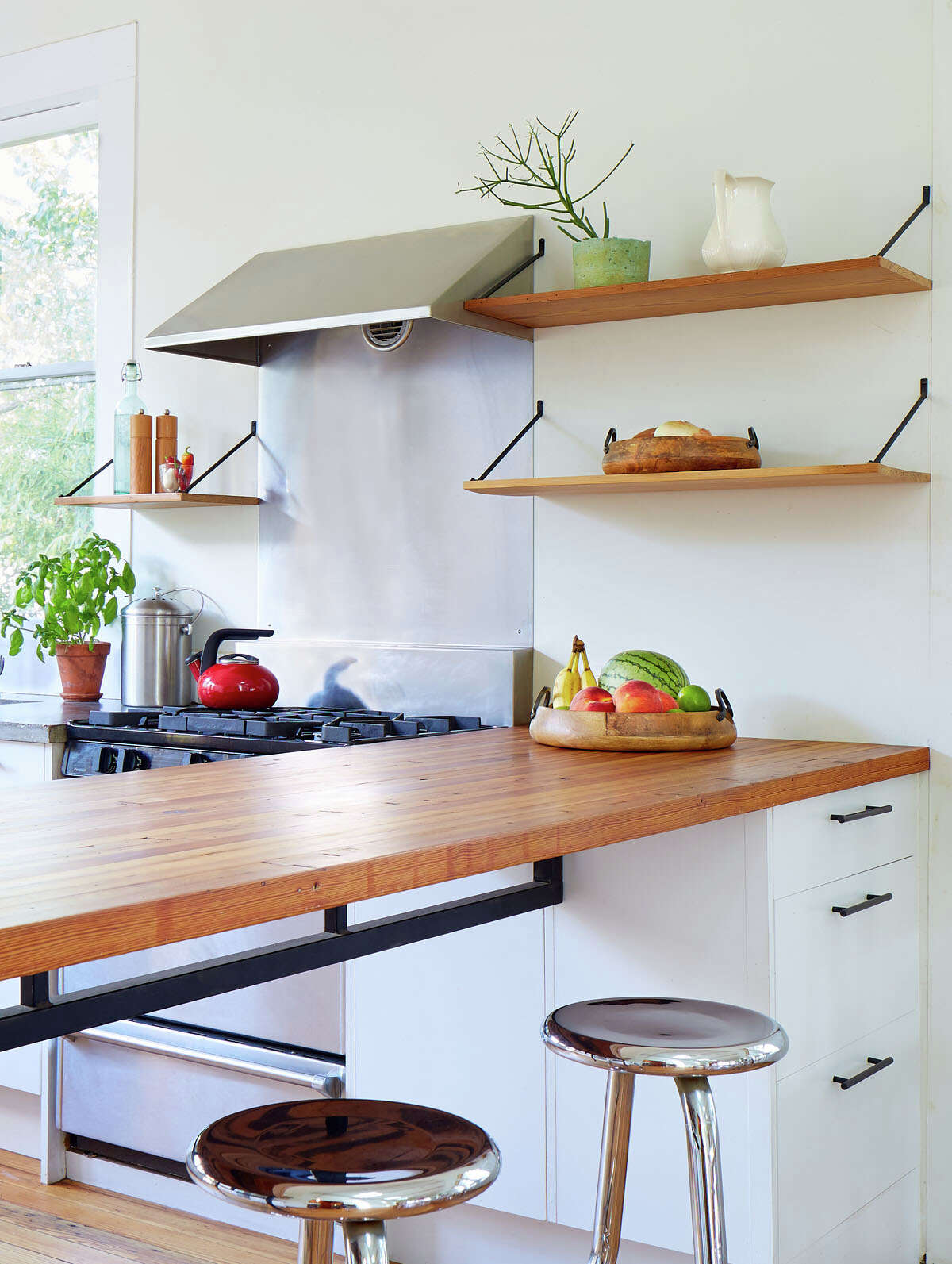 Cotton Estes' kitchen in her Dignowity house features a counter of reclaimed wood.