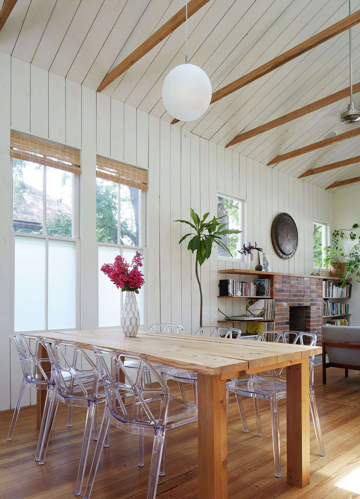 The dining room table was made of wood reclaimed from another part of the house.