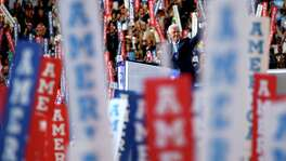 Waving to the crowd, former President Bill Clinton hits the stage after his wife was awarded the presidential nomination at the Democratic National Convention. A reader wonders why a photo of Bill Clinton made the front page when it was Hillary's night.