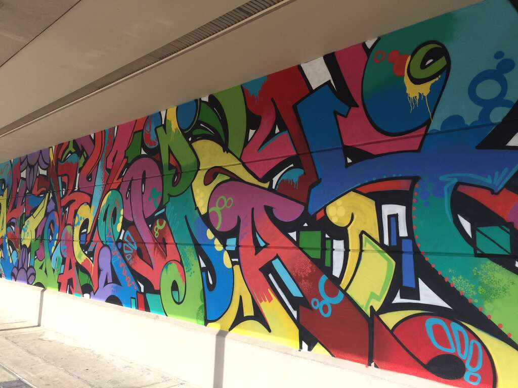 New Gonzo Mural Goes Up At Rice Village Houston Chronicle - Cartoon mural man obsessing facebook likes says lot society