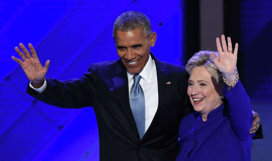 President Barack Obama and Democratic presidential nominee Hillary Clinton wave from the stage during the Democratic National Convention. Why is she running in the first place? Like most dynastic candidates (most famously Ted Kennedy in 1979), she really doesn't know. She seeks the office because, well, it's the next — the final — step on the ladder. Photo: SAUL LOEB /AFP /Getty Images / AFP or licensors