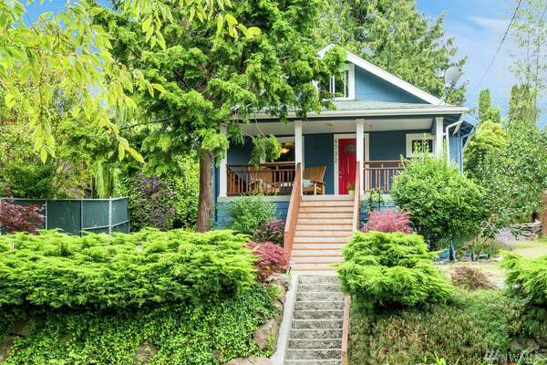 The first home, 9732 59th Ave. S., is listed for $343,000. The two bedroom, one bathroom home is in the Rainier Beach neighborhood.   The home sits up from the street and features view of the Hutchinson Playground. The home has a new front porch, gutters and a recently remodeled bathroom. It is 1,370 square feet.   There will be a showing for this home on Saturday, July 30 and Sunday, July 31 from 1 - 4 p.m.  You can see the full listing here .