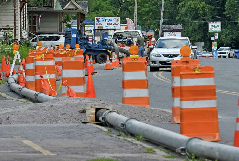 Repair work is being done on a sewage leak along Forest Avenue on Friday July 29, 2016 in Amsterdam, N.Y. Untreated sewage spilled into Chuctanunda Creek, which flows into the Mohawk River. (Michael P. Farrell/Times Union)