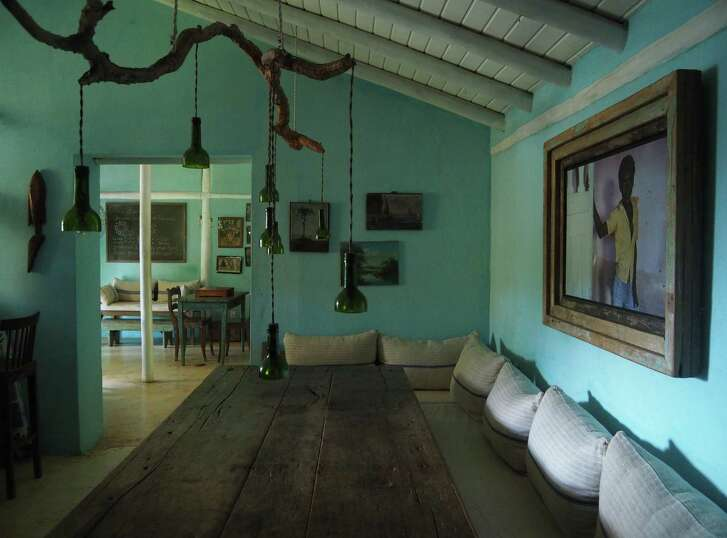 Turquoise-colored walls set the perfect tone to highlight Brazilian artisans at the UXUA Casa Hotel in Trancoso.