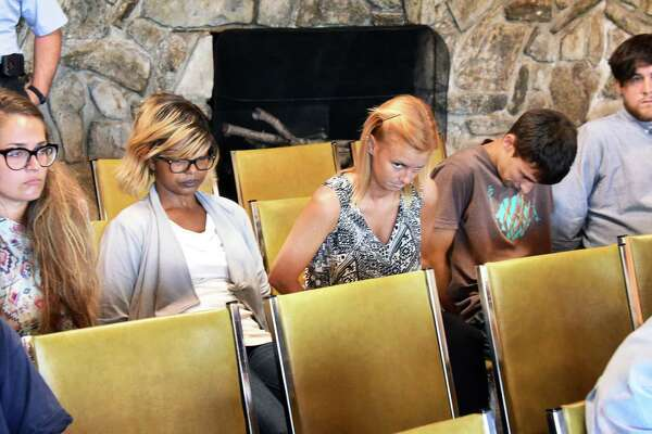 Five defendants, from left, Cara Mia Canale, Morland Keyes, Kristine Tiger, Alex West and Matthew Marry await arraignments in a fatal boating accident in Lake George Town Court Friday July 29, 2016 in Lake George, NY.  (John Carl D'Annibale / Times Union)