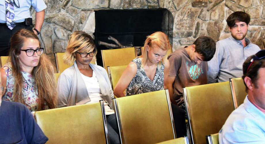 Five defendants, from left, Cara Mia Canale, Morland Keyes, Kristine Tiger, Alex West and Matthew Marry await arraignments in a fatal boating accident in Lake George Town Court Friday July 29, 2016 in Lake George, NY.  (John Carl D'Annibale / Times Union) Photo: John Carl D'Annibale / 20037505A
