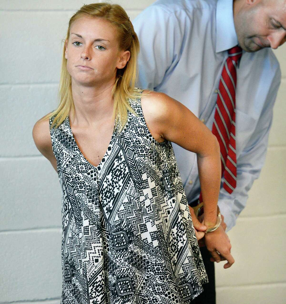 Kristine Tiger has her hand cuffs removed during her arraignment on Friday July 29, 2016, at Lake George Town Court in Lake George, NY. (John Carl D'Annibale / Times Union)