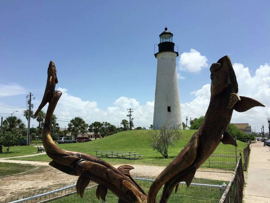 South Padre Island is an ideal location for a port of call, according a recent study. Pictured, a wood carving of fish with the Port Isabel lighthouse in the backdrop. Photo: Aaron Nelsen / San Antonio Express-News