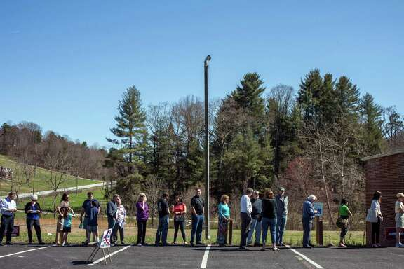 Unlike on Super Tuesday, back on March 15, voters in North Carolina will not be required to show certain photo identification before voting in person. The state's voter ID law was held as discriminatory and struck down by a federal appeals court on Friday.