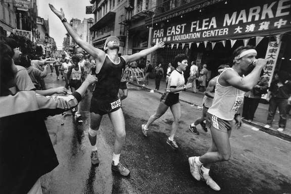 Runners on Grant St. with  13 miles left  of the  San Francisco Marathon   photo ran 08/20/1984, p. 47