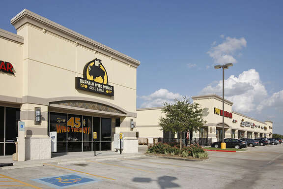 Buffalo Wild Wings is a tenant at Spring Town Center, 2116 Kuykendahl at FM 2929.