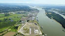 Tesoro Corp., with partner Savage Cos., wants to deliver crude oil by rail to the area in the foreground of this aerial photo of the Port of Vancouver USA on the Columbia River. A marine dock also will be added at the port.
