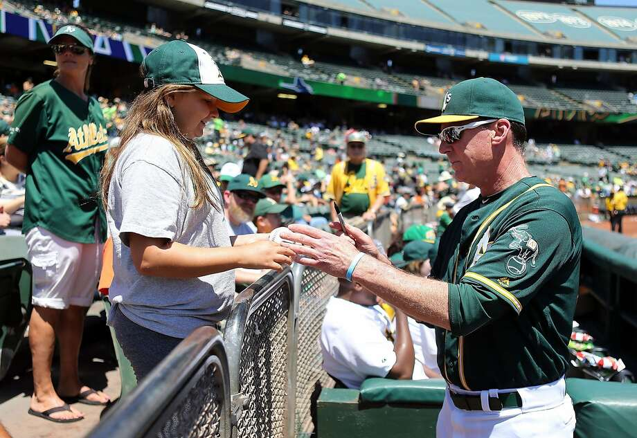 OAKLAND, CA - JULY 24:  Manager Bob Melvin #6 of the Oakland Athletics sings an autograph for a fan before the game against the Tampa Bay Rays at the Oakland-Alameda Coliseum on July 24, 2016 in Oakland, California.  (Photo by Don Feria/Getty Images) Photo: Don Feria, Getty Images