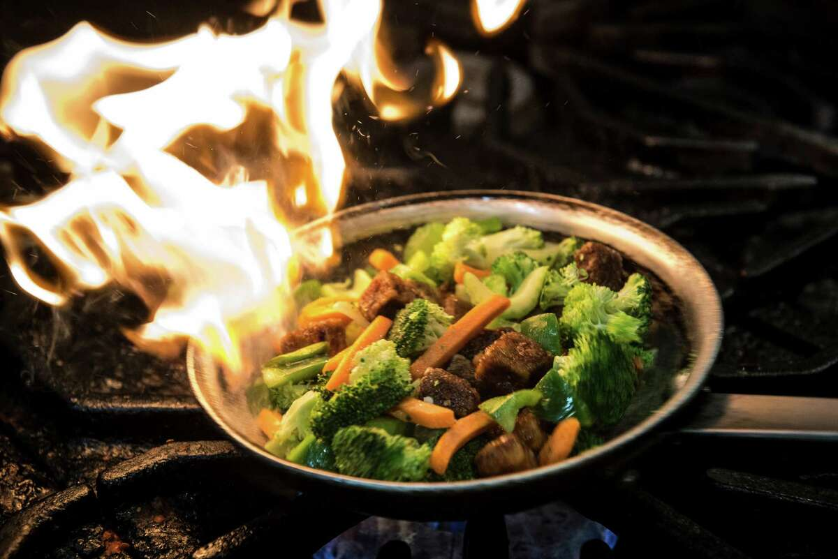 A dish of Cece's Stir Fry is cooked up at Green Vegetarian Cuisine located at The Pearl in San Antonio, Texas on Friday, July 29, 2016.
