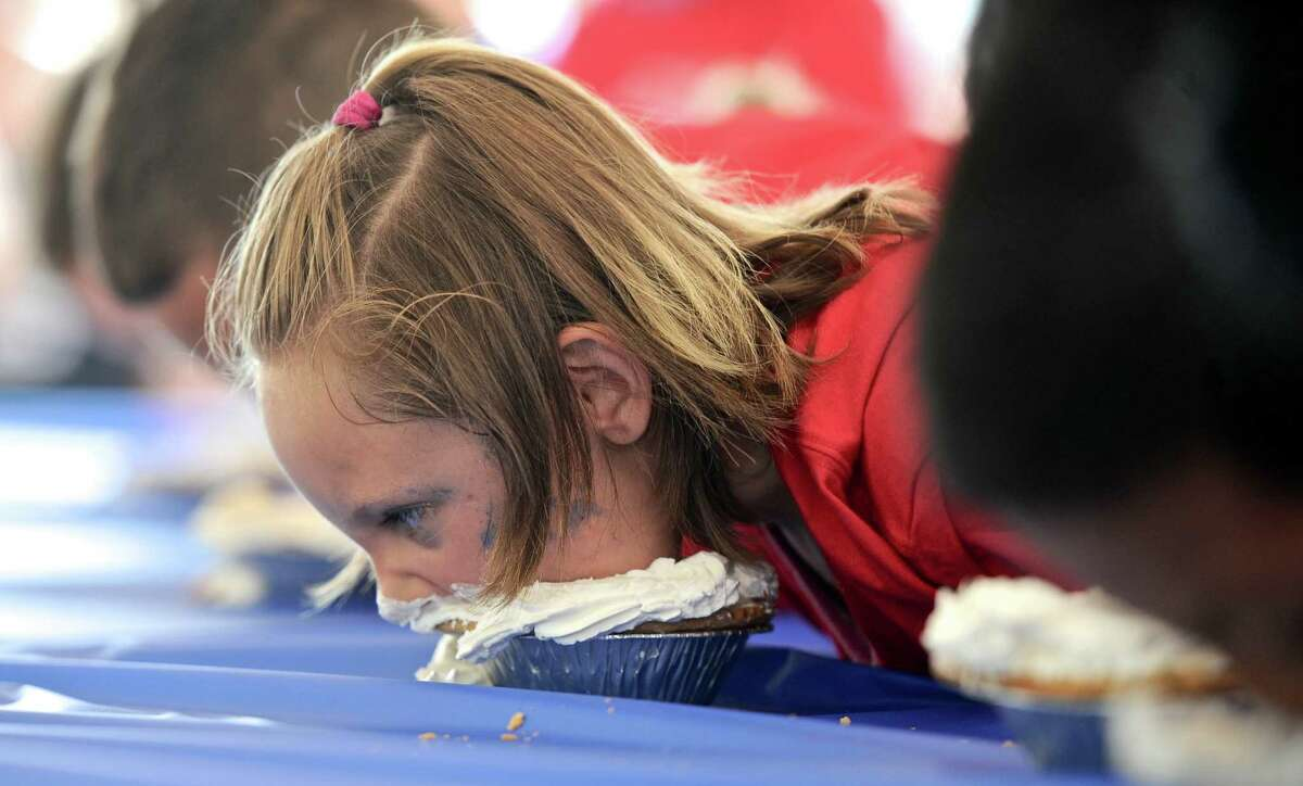 Payton Bixler, 6, of New Milford, digs into a cream pie during The American Pie Company pie eating contest at the Village Fair Days, Friday, July 29, 2016, in New Milford, Conn.