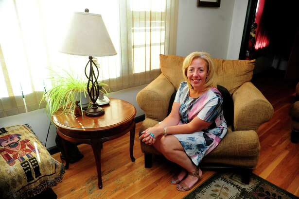 Annette Segarra-Negron, who has been appointed by Mayor Joe Ganim to the Bridgeport Board of Education, poses at her home in Bridgeport, Conn., on Friday July 29, 2016.