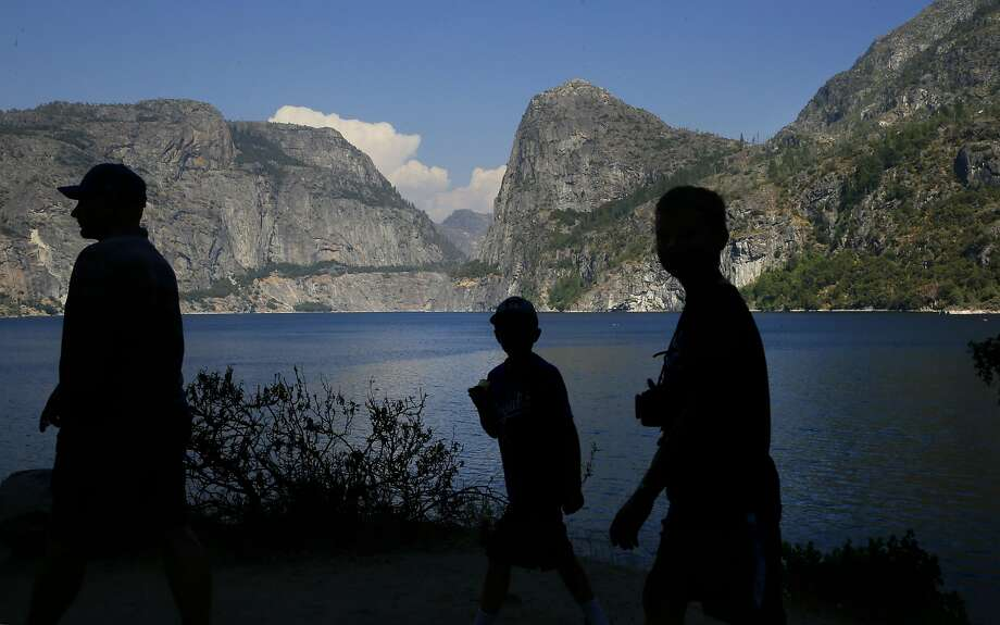 Visitors explore the shoreline of Hetch Hetchy reservoir in Yosemite National Park, California, on Thurs. July 28, 2016. Photo: Michael Macor, The Chronicle