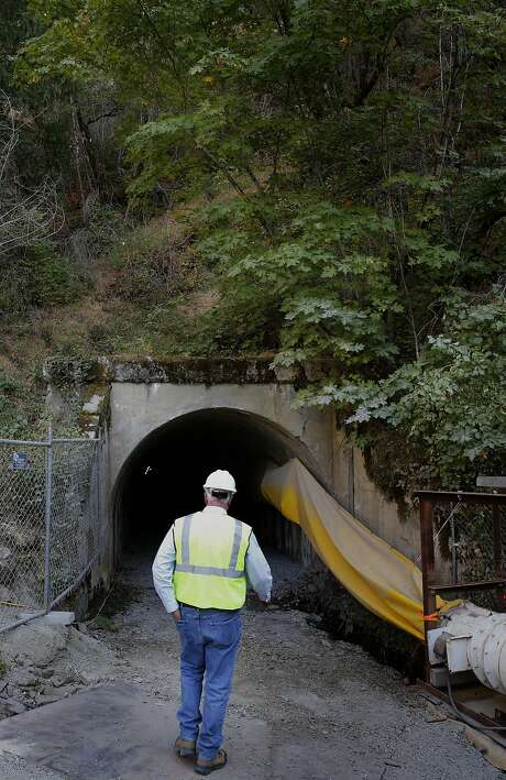Steve Ritchie of the San Francisco Public Utilities Commission walks toward an adit, which provides access to the Mountain Tunnel near Groveland (Tuolumne County). Photo: Michael Macor, The Chronicle