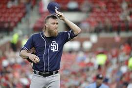 San Diego Padres starting pitcher Andrew Cashner pauses on the mound during the fourth inning of a baseball game against the St. Louis Cardinals Thursday, July 21, 2016, in St. Louis. (AP Photo/Jeff Roberson)