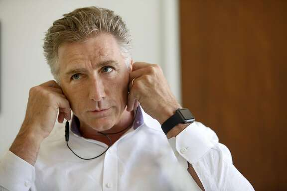 Logitech CEO Bracken Darrell talks about wireless earbuds on Friday, July 29, 2016, in San Francisco, Calif.