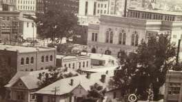 "A panoramic photo of downtown Houston shows the Municipal Auditorium and several ""female boarding houses"" nearby."