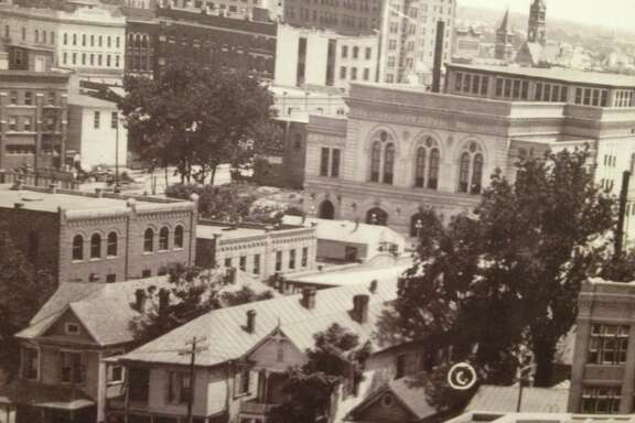 """A panoramic photo of downtown Houston shows the Municipal Auditorium and several """"female boarding houses"""" nearby."""