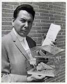 """07/13/1965 -  A PREGNANT PARAKEET?   This pair of parakeets were all Deputy Sheriff Marvin Zindler got when he served a court order for a $487.43 judgment against Dr. C. W. Thompson III, at 2117 Dowling. As the deputy started to leave with the birds, the nurse told him the female of the pair was """"in a family way"""" and to be careful with them. Zindler carefully took the birds home to await the next sheriff's sale."""