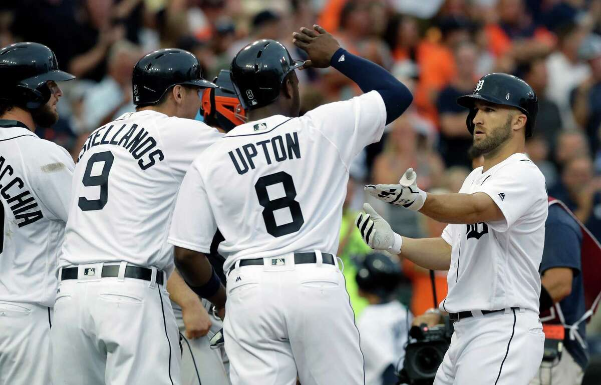 July 29: Tigers 14, Astros 6 Detroit Tigers' Tyler Collins, right, is greeted at home plate by Jarrod Saltalamacchia, left, Nick Castellanos (9) and Justin Upton (8), after his three-run home run during the second inning of a baseball game against the Houston Astros, Friday, July 29, 2016, in Detroit. (AP Photo/Carlos Osorio)