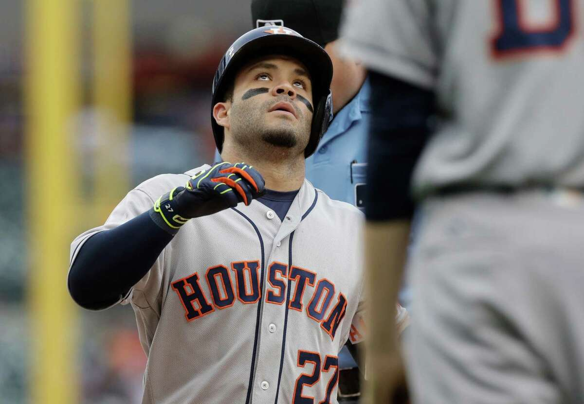 Houston Astros' Jose Altuve looks skyward after his two-run home run during the first inning of a baseball game against the Detroit Tigers, Friday, July 29, 2016, in Detroit. (AP Photo/Carlos Osorio)