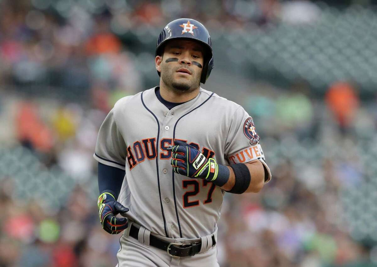 Houston Astros' Jose Altuve rounds the bases after a two-run home run during the first inning of a baseball game against the Detroit Tigers, Friday, July 29, 2016, in Detroit. (AP Photo/Carlos Osorio)