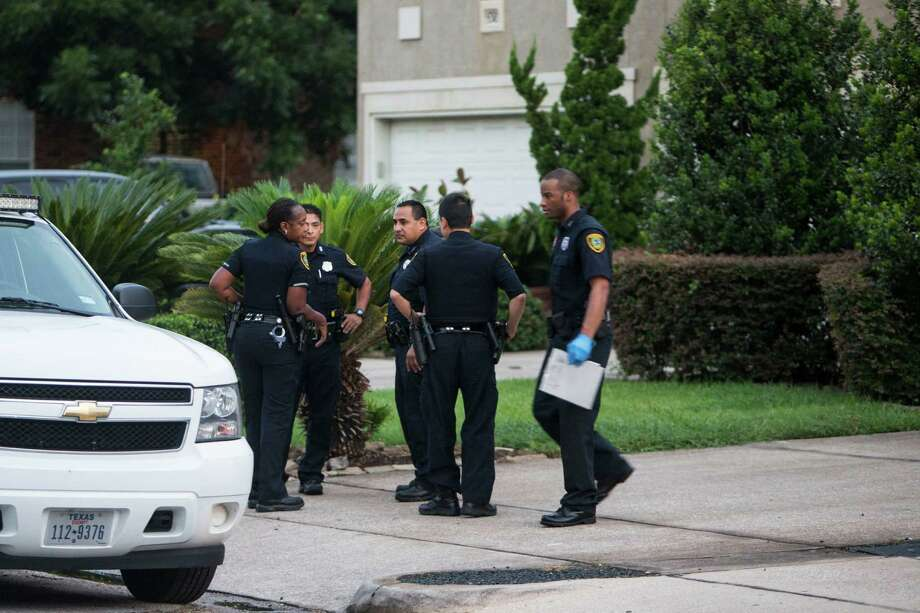 Police investigate a shooting in the 5300 block of Palmetto on Friday. Dawn Armstrong died at the scene, and her husband, former All-American A&M football player who was briefly in the NFL, died later at Memorial Hermann. Their teen son was arrested. Photo: Brett Coomer, Staff / © 2016 Houston Chronicle