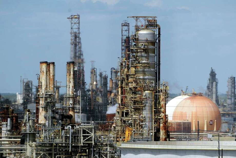 Exxon Mobil Corp. is expanding its Beaumont refinery, pictured here, and will expand its Beaumont Polyethylene Plant. Photo: Jake Daniels / ©2015 The Beaumont Enterprise/Jake Daniels