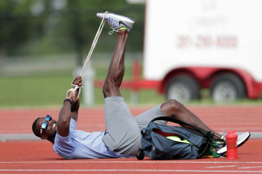 Justin Gatlin stretches out before the United States Track & Field Olympic Team open workout at Blackshear Field in Prairie View, TX, on Friday, July 29, 2016. Photo: Tim Warner, For The Chronicle / Houston Chronicle