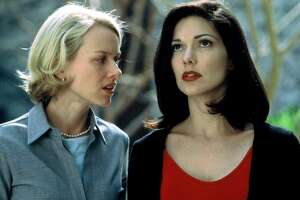 "Actors Laura Elena Harring, right, and Noami Watts, are seen in an undated handout photo from the film ""Mulholland Drive"", directed by David Lynch.  ""Mulholland Drive,'' tied with ""Memento,'' Christopher Nolan's revenge tale told in reverse, as the Online Film Critics Society's best movie of 2001.     ""Mulholland Drive'' won five other awards from the online group on Wednesday, Jan. 2, 2002 including best director and best original screenplay for Lynch, best actress and breakthrough performance for Naomi Watts, and best score for Angelo Badalamenti.  (AP Photo/HO)"