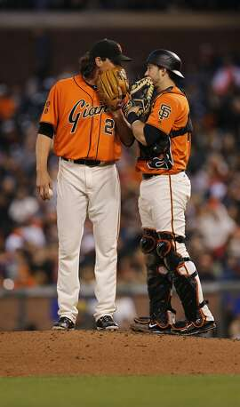 Giants strarting pitcher Jeff Samardzja nad catcher TRevor Brown talk things over in the third inning, as the San Francisco Giants take on the Washington Nationals at AT&T Park in San Francisco, California, on Fri. July 29, 2016.