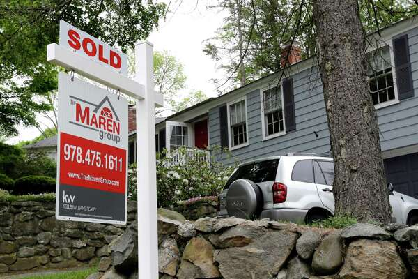 """FILE - This Tuesday, May 24, 2016, file photo shows a """"Sold"""" sign in front of a house in Andover, Mass. On Wednesday, July 27, the National Association of Realtors releases its June report on pending home sales, which are seen as a barometer of future purchases. (AP Photo/Elise Amendola, File)"""