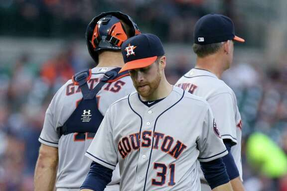 Astros starter Collin McHugh gets an early shower after leaving the game in second inning.