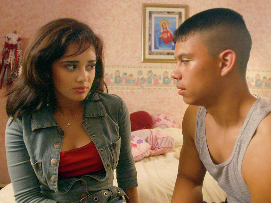 """Teen actors Mirna Garcia, left, and Robert Cerda, act out a scene while making the movie """"Toothpaste,"""" a film that addresses teen pregnancy issues, in Mission, Texas, in this May 11, 2004 photo. Photo: JOEL MARTINEZ /AP / AP"""