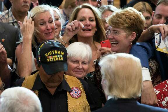Members of the crowd reach out to Republican presidential candidate Donald Trump during a goodbye reception following the Republican National Convention. Readers comment on the vision put forth by the candidate during the convention.