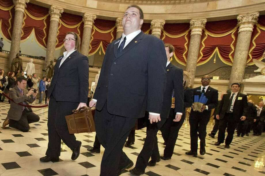 Pages lead a Senate procession carrying Electoral College votes on Jan. 4, 2013. If Democrats move to dismantle the Electoral College, they can't claim to be the part of the downtrodden. Photo: Associated Press File Photo / AP