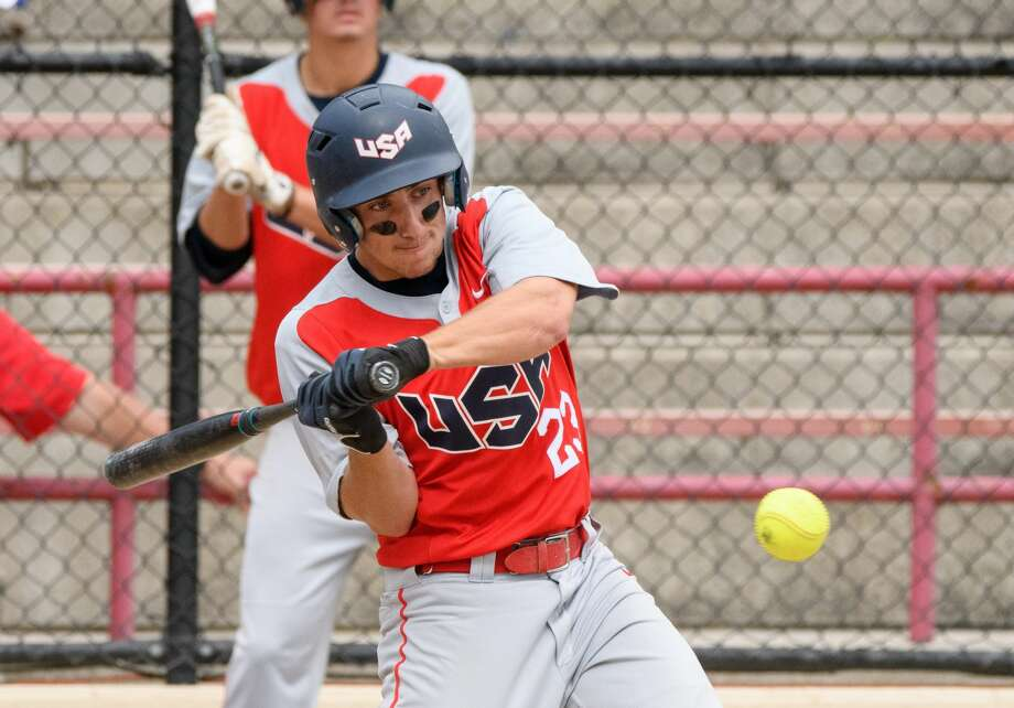 USA's #23 Matthew Martin at bat against Canada at the Junior World Championship Fastpitch softball tournament at Emerson Park Friday. Photo: STEVEN SIMPKINS | For The Daily News