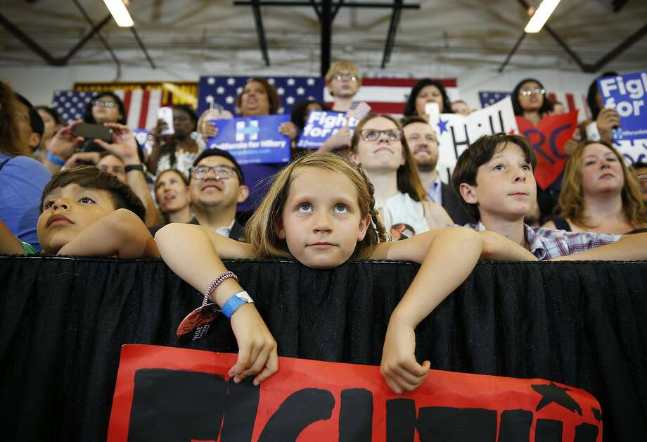 A girl listens as Democratic presidential candidate Hillary Clinton speaks at a rally at Sacramento City College, Sunday, June 5, 2016, in Sacramento, Calif.  Photo: John Locher, Associated Press