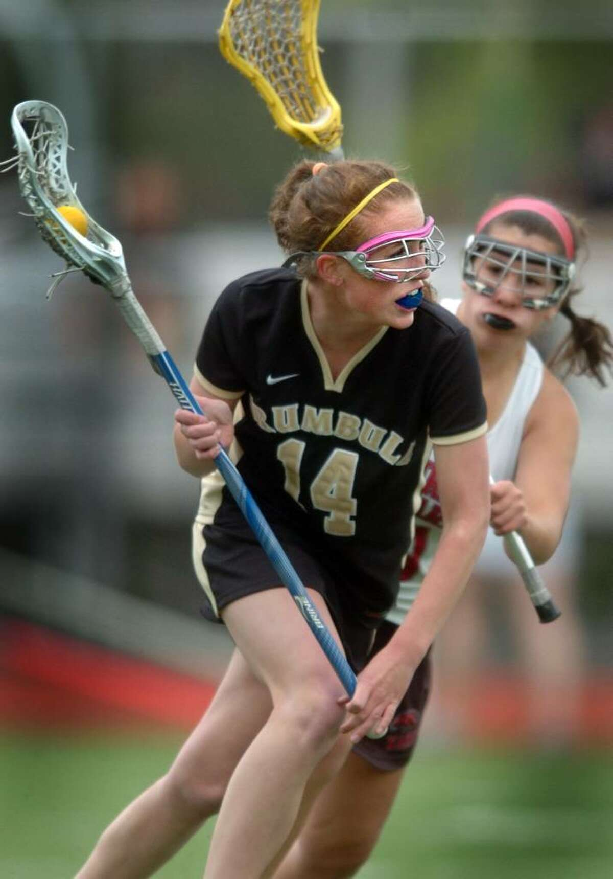 Trumbull's Mary Rose Rappa pushes past Fairfield Warde's Sophia Sophia Catandella Wednesday Apr. 28, 2010 during their lacrosse match in Fairfield.